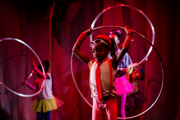 Young members of the community perform their hula hoop skills on stage